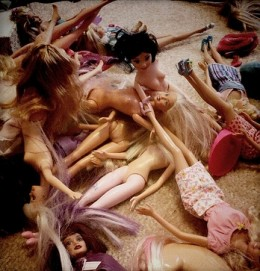A collection of Barbies in need of love and attention.