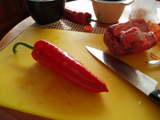 Red pepper with piece of shin bone