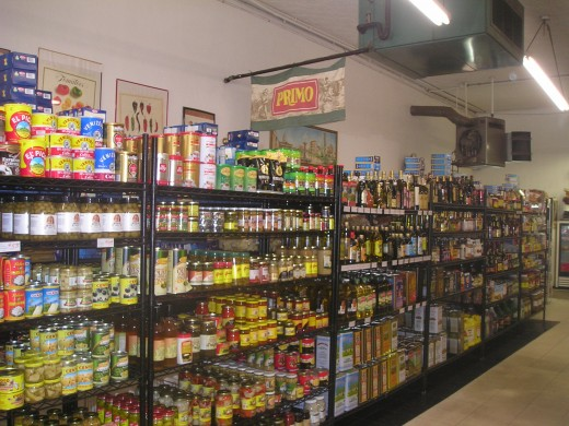 Bottles of Imported olive oils line the shelves of Viviano's on the Hill