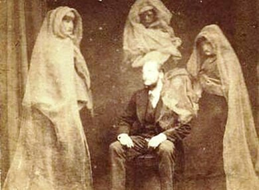 "Hudson (1875): Mr. Raby with the Spirits ""Countess,"" ""James Lombard,"" ""Tommy,"" and the Spirit of Mr. Wootton's Mother."