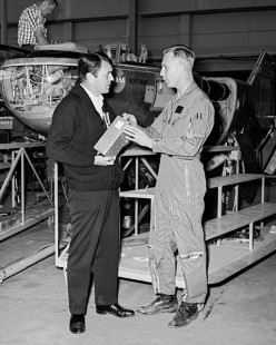 James Doohan (left) visiting NASA Dryden Flight Research Center at Edwards, California, is discussing the M2-F2 Lifting Body with NASA pilot Bruce Peterson