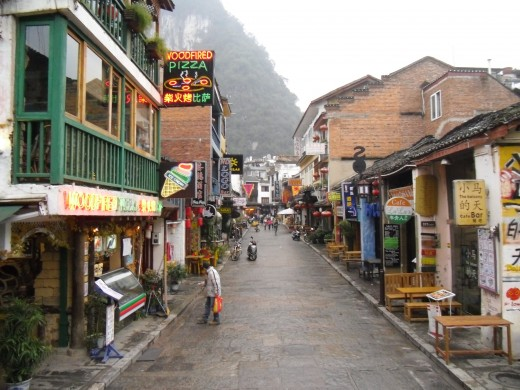 This is West St. in Yangshuo China. This is a slow day during the off peak season. During summer the street is much more crowded.