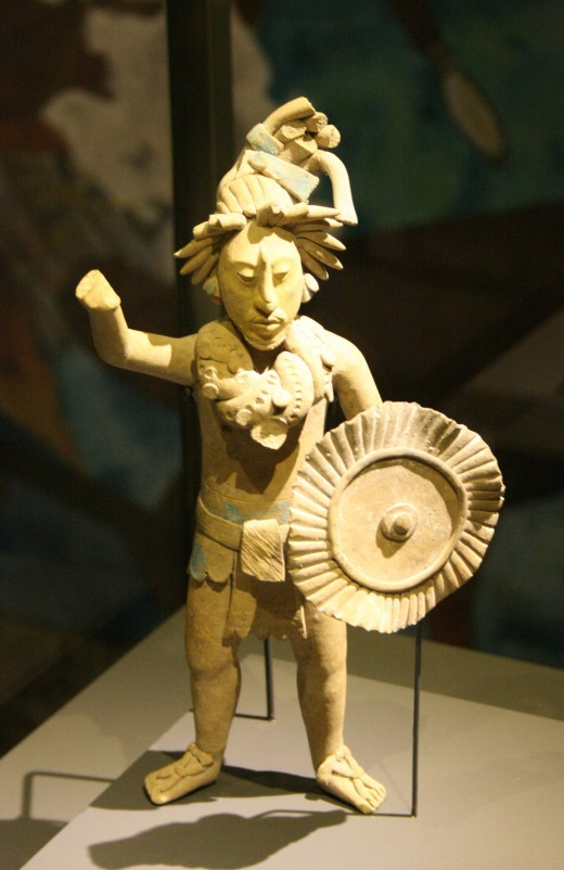 Mayan warrior figurine found on Jaina Island. It is located in the Musées Royaux d'Art et d'Histoire, Brussels (Belgium).