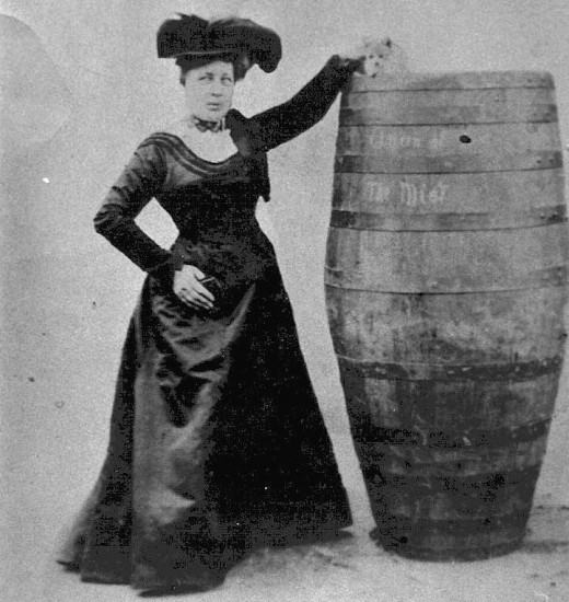 Annie Edson Taylor with barrel and cat. Many stories surrounded this cat including that is was killed, and that it entered the barrel black but exited white in color.