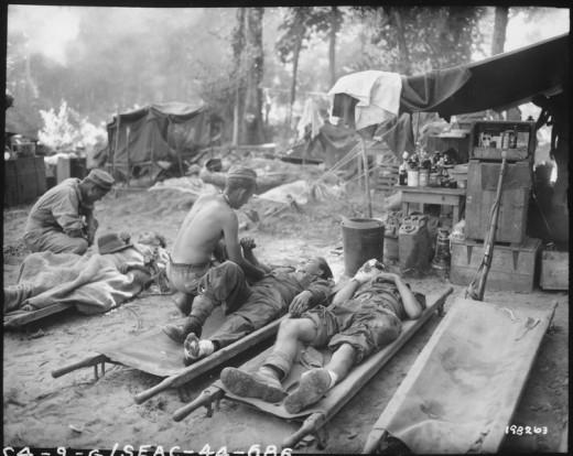 American medical staff treat casualties in Burma