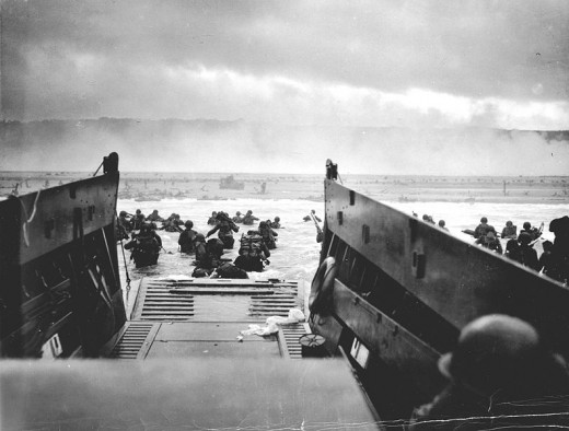 Troops head for shore on D-day under heavy fire from German guns.