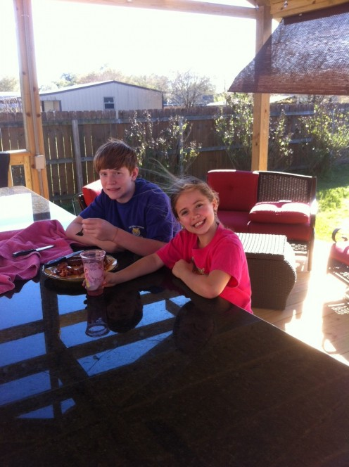 My kids enjoy some hotdogs and burgers on our new deck.