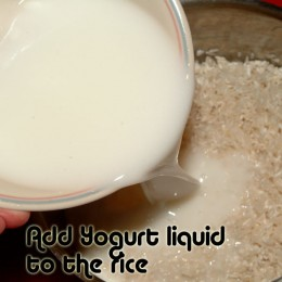 Pour the liquid yogurt over the rice.