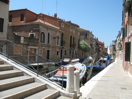 Venice - view with bridge steps and sidewalk edging canal.