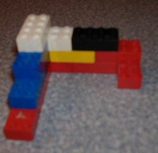 Toys like Legos, Tinker-toys, and Lincoln logs can be great for making miniatures of projects.