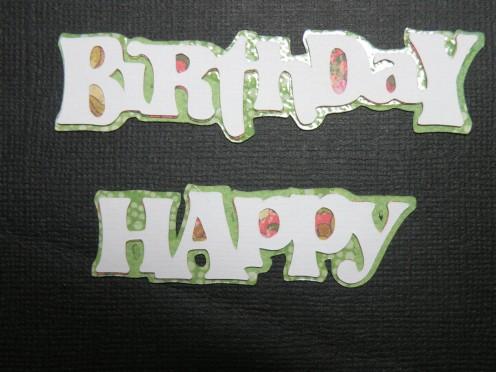 Happy Birthday phrase adhered