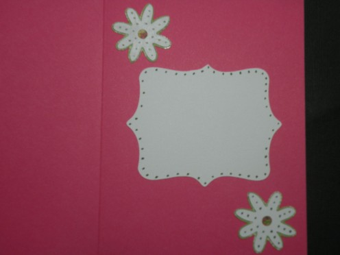 Small daisy layers adhered to card