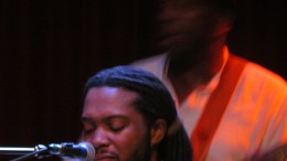 Winston Ferguson, plays behind Dordon. He is the band's leader who plays an incomprehensible bass.