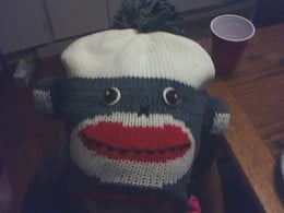 My young neighbor wearing a sock monkey cap!