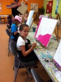 Art camp for a day may be a good activity for your child.