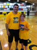 My son with the head coach at the end of a local basketball camp last year.