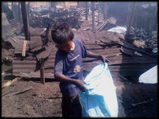 mark, 11 year old boy working at the charcoal factory to help his family :(