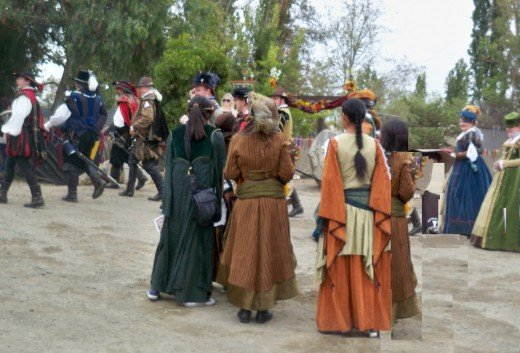 Visitors in Renaissance clothing, characters in Renaissance Faire.