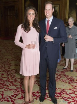 Kate in a pleated Emilia Wickstead dress with Prince William at the Queen's Sovereign luncheon