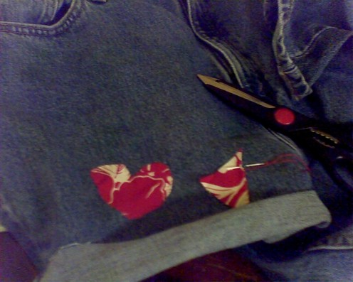 4. Glue and sew the designs on.Make sure your cuff is even.