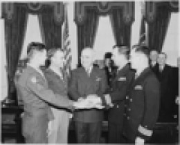 "Fr. O'Callahan (far right) being presented the Medal of Honor with 3 others by President Truman. Next to O""Callaghan is LtJg Donald Gary who also won his Medal of Honor aboard the Franklin that day. He rescued more than 300 trapped men below deck."