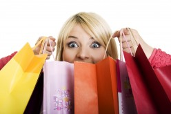 Why are women often seen as fanatic shoppers?