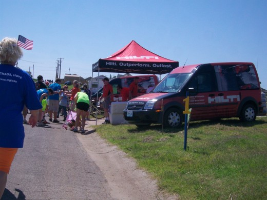 Many businesses set up tents along the rout to give out water and refreshments.