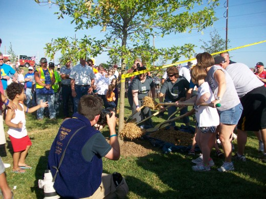 Ceremony dedicating the last of 161 trees planted in the park to commemorate those who died in the tornado.