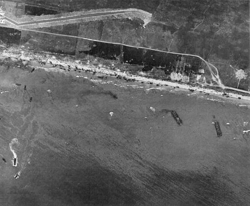 """""""Aerial view of Omaha Beach, Normandy, France, taken 6 June 1944, showing landing of two infantry regiments 18th and 115th, vehicles, and landing craft."""""""
