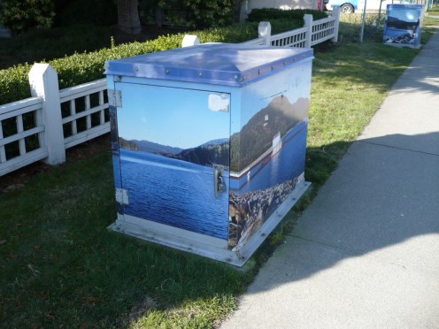 The boxes are painted with BC landscapes.