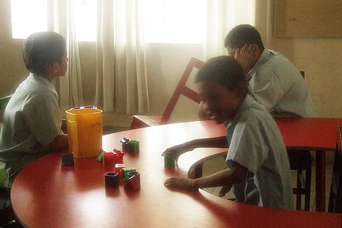 Autistic Boys in a center playing