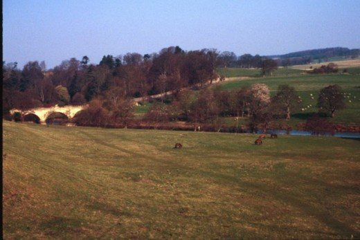 From Alnwick Castle the ground slopes to the River Aln. A former duke reconstructed the stream and moved a village to improve his view.
