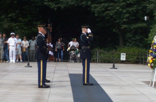 The soldier rose to his feet to salute with the Guard