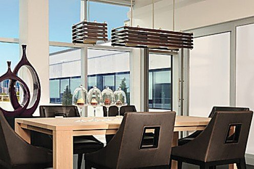 Choose lighting fixtures that pick up on the contemporary vibe of your room.
