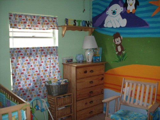 THE FLUFFY FANCIFUL CRITTERS ON THE WALLS WERE THERE FOR THE GRANDBOY'S FIRST 22 MONTHS.