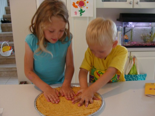 The kids had fun pressing the crumbs onto the pan.