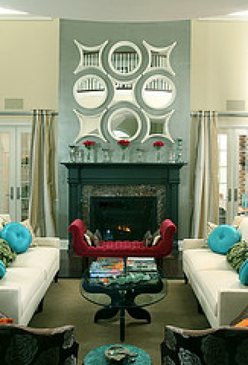 The fireplace and mirror collection exemplifies emphasis in a room.