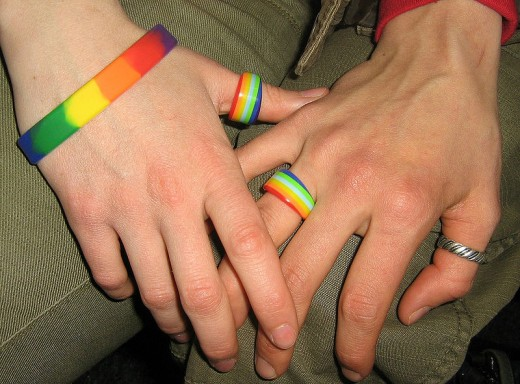 Two women holding hands in support of same sex marriage