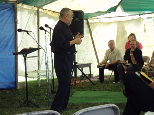Dr. Terry VanBuskirk preaching at tent revival South Dayton Baptist Church
