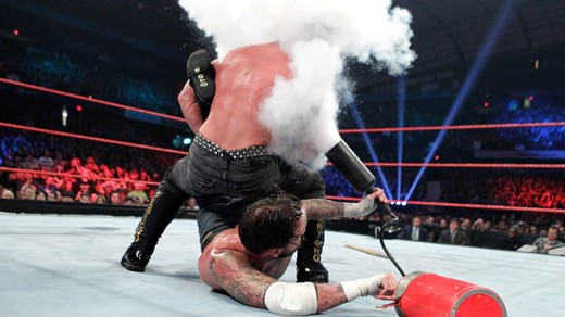 CM Punk uses a fire extinguisher on Chris Jericho