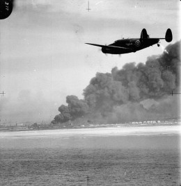 A Lockheed Hudson of No. 220 Squadron RAF approaches Dunkirk on a reconnaissance patrol during the evacuation of the British Expeditionary Force.