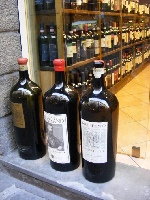 Florence - Large wine bottles in front of a wine shop.