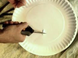 Cut the hole off center. This aides you to balance the plate to the shape of the head.