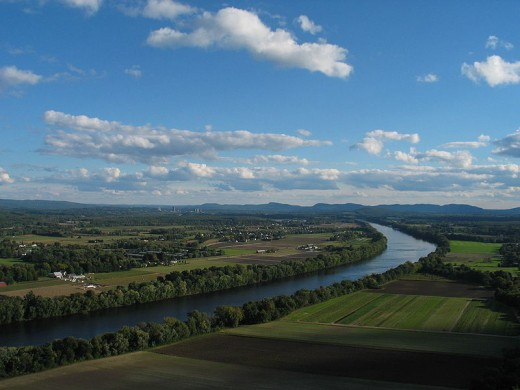 The Connecticut River, looking south from Sunderland (near Deerfield) toward Hadley. Mount Holyoke Range at Suth Hadley is at background.