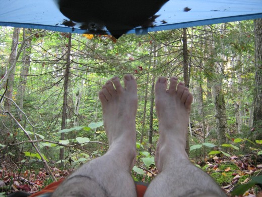 Tarp camping is a great opportunity to take off your shoes and let the breezes circulate around your body.