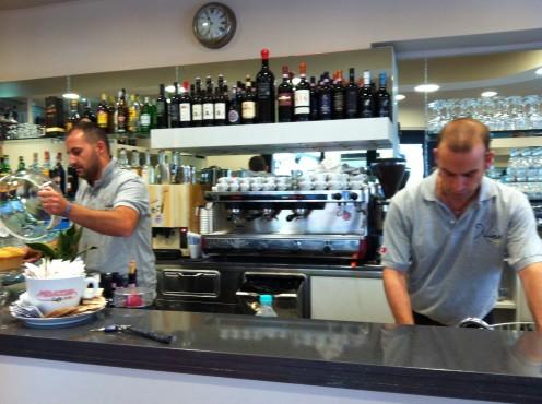 Two barmen at my local bar Nina Cafe, Fonteblanda Tuscany.