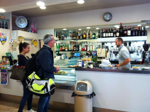 Ordering and paying at the cash register of the Italian Bar
