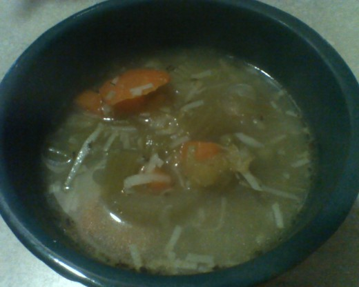 My Hearty Harvest Vegetable Soup garnished with shredded cheese