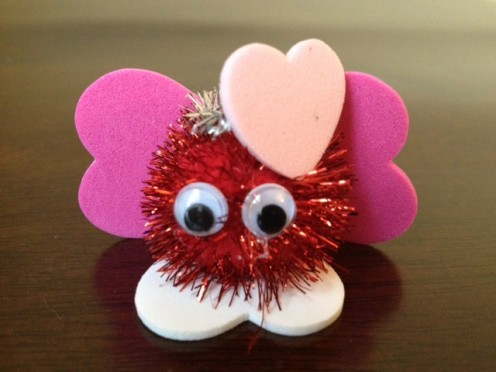 A heart-y critter created by using foam hearts, googly eyes, a pom-pom and a pipe cleaner.