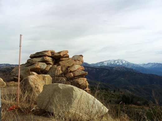 Boulders spotted on the Rim of the World Highway with the view of Mount San Gorgonio in the distance.